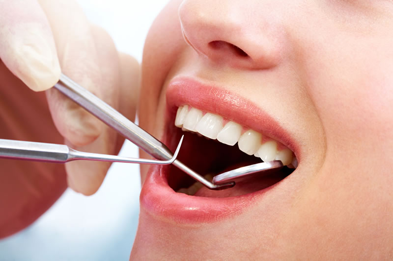 check ups and cleanings - dental instruments in mouth