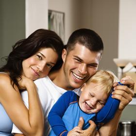 Mississauga Dentist - family of three smiling